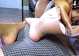 Sexy black explicit teasing cock with her feet