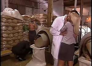 Sexual orgy in a factory with two blonde sluts