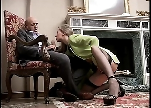 Dapper and sexy girl roughly high heels and stockings sucking a cock