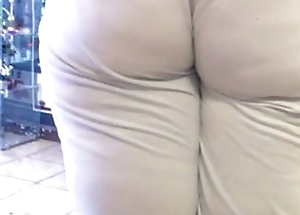 White jumpsuit sucked up by gigantic bbw ass