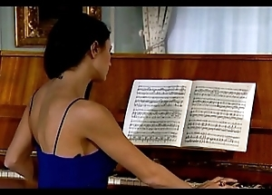 Sofia Cuci playing piano while couple is fucking on chaise longue