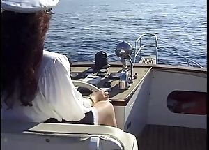 Hot captain Jessica Rizzo has sex about a woman in a boat