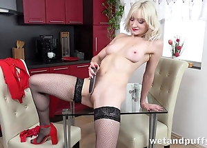Sexy bazaar in the matter of nylons pleases herself with sex toy