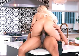 Sexy flaxen-haired anally rides lover's BBC in the kitchen