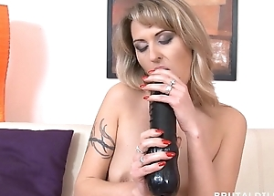 Tattood blonde Laura cumming distance from a really thick sex-toy